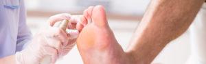 Podiatrist treating man's feet