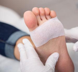 Podiatrist cleaning toenails